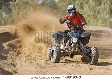 ATV Rider in the action on sand road