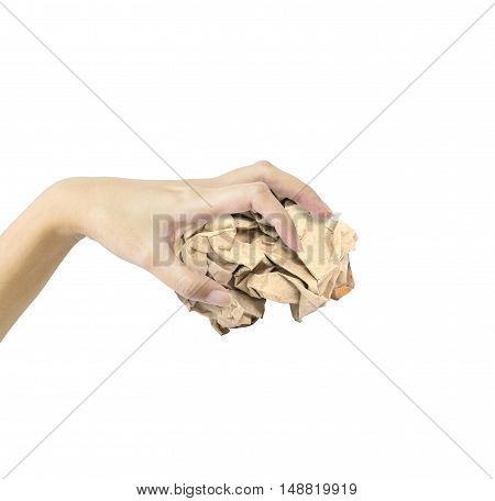 Closeup action of woman hand catching brown crumpled paper in hand isolated on white background