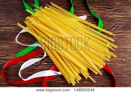 Uncooked Authenric Tripoline spaghetti pasta with italian flag style ribbons.