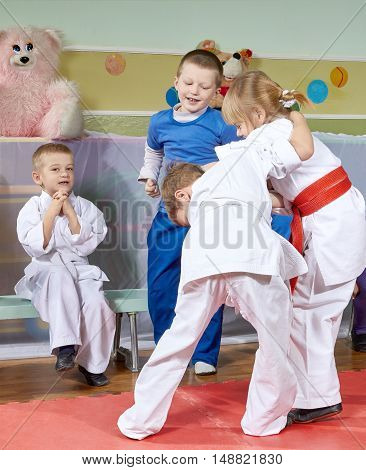 Girl and boy are trained judo sparring