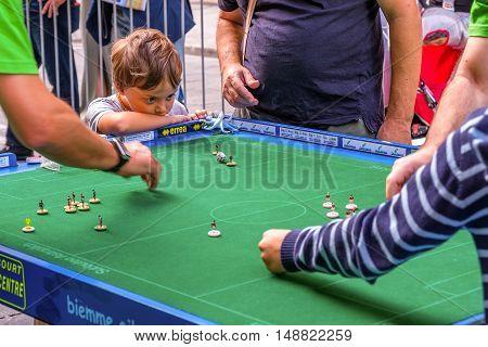Bologna Italy 18 September 2016: A child focusing on a Subbuteo game