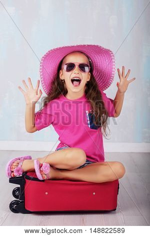 emotional child happy in suitcase. The concept of travel and lifestyle.