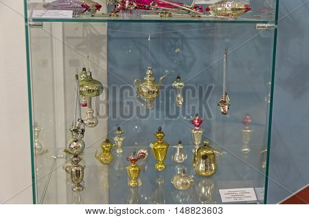 KLIN RUSSIA - JANUARY 16 2016: Old Christmas decorations in the form of teapots coffee pots and samovars. Museum of Christmas toys.