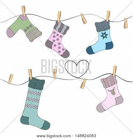 Set of colorful socks on a rope with clothespins.