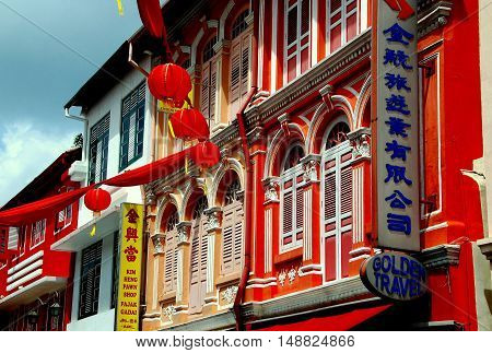 Singapore - December 14 2007: Splendidly restored and colourfully painted 19th century Chinese shop houses on Temple Street in Chinatown