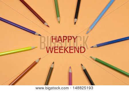 Colored Pen written showing to center with a word happy weekend