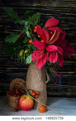 Fall Still Life with Pumpkins, cornucopia and fresh fruits. Vertical Composition.
