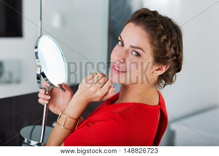 Beautiful Woman With A Mirror