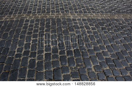Urban stone paving stones. Texture side view.