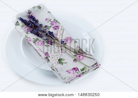 Dining table setting at Provence style with lavender on old wooden white background
