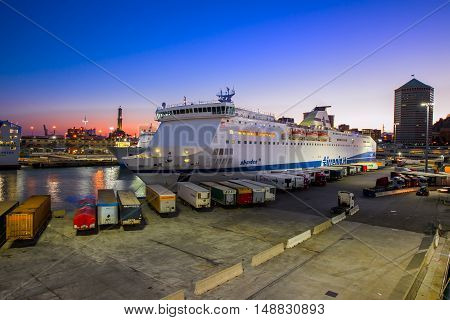 GENOVA, ITALIA - August 24, 2016 - Tirrenia Ferry terminal in the harbour of Genoa. Genoa is one of Europe's largest cities on the Mediterranean Sea and the largest seaport in Italy.