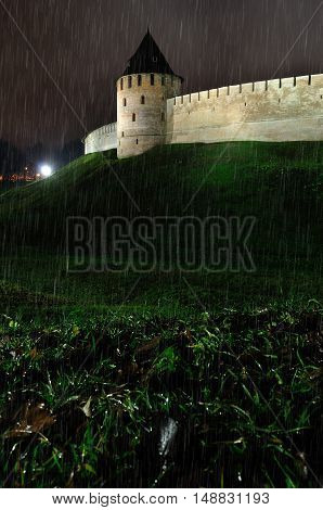 Architecture view of Fedorov tower of Novgorod Kremlin fortress in Veliky Novgorod by autumn night under falling rain Russi