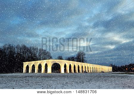 Architecture winter view of illuminated arcade of ancient trades at Yaroslav's Courtyard in Veliky Novgorod Russia - architecture night landscape of Veliky Novgorod Russia