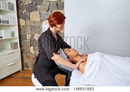 Shoulders neck massage physiotherapist woman indoor