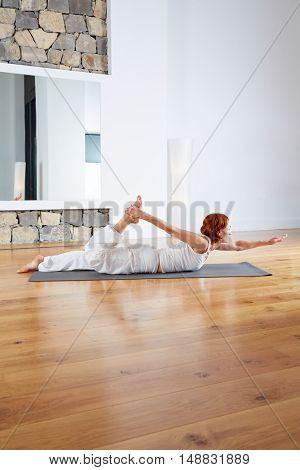 Yoga exercise in wooden floor gym and mirror indoor