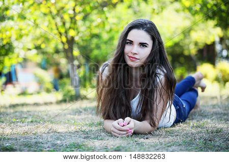 woman lying on the grass in the park