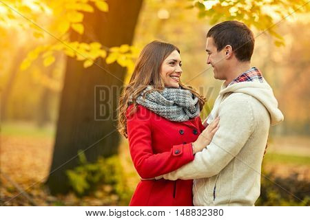 Cheerful young couple in love in park