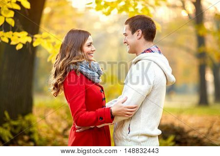 Cute young woman and man in park