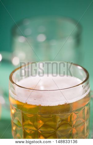 glass of beer with reflection in studio .