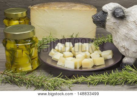 cheese in olive oil, oregano and rosemary, sheep on the table
