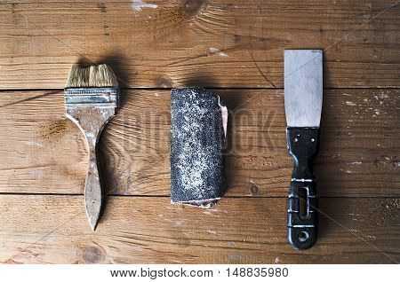 Old Brush, Sandpaper And Trowel