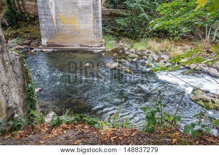 The Tumwater River flows beneath a bridge.