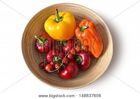 the fresh ripe red yellow orange peppers on a plate, home grown autumn harvest - isolated background - clipping path