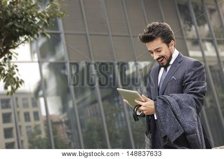 Businessman checking his tablet