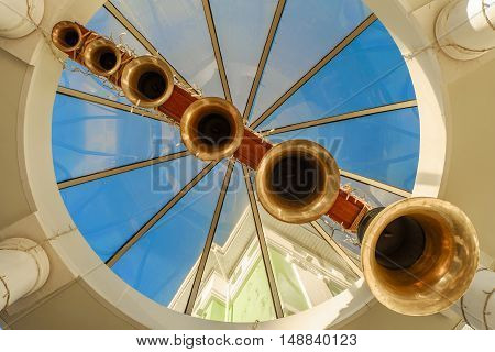 Under the bells. Abstract view from below of a number of church bells. Six bells varying in ranks.