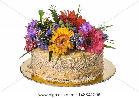 Cake decorated with fresh flowers. On a white background.