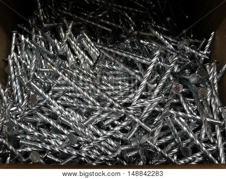 Carpenters equipment. Iron roofing nails in box at hardware store