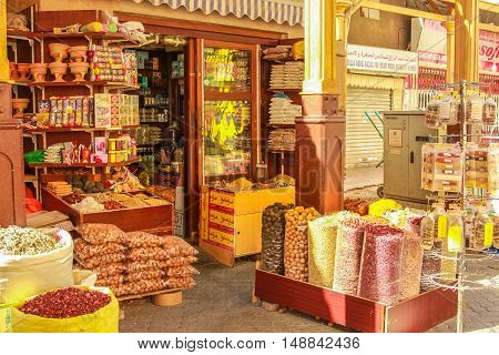 Dubai, UAE - May 3, 2013: a typical colors spice shop in Old Deira. The Grand Souk Deira is an entire neighborhood of narrow streets and dark and bottege selling spices, gold, perfumes.