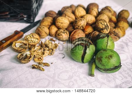 Walnuts and a knife on a whit background. Vintage style. selective focus, Concept of healthy food to health.