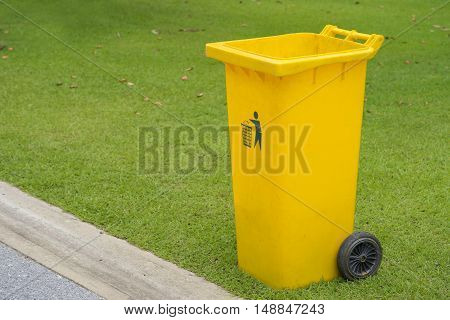 close up of yellow bins in public park