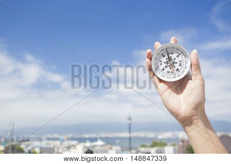 Compass in the hand for travel location
