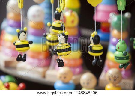 Street market stall full of handmade wooden toys