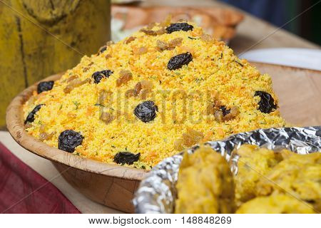 Large bowl of couscous with dried plums and raisin