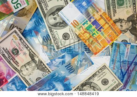 Background made of dollar and swiss franc banknotes