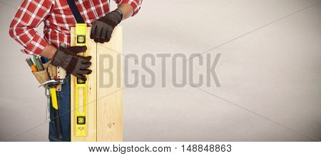 Builder with level and wooden planks.