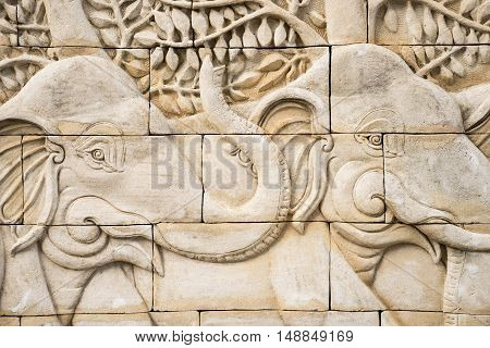 Low relief cement Thai style handcraft of elephant