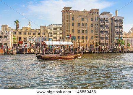 Dubai, United Arab Emirates - May 3, 2013: a traditional Abra ferry along Dubai Creek that divides the city in: Deira and Bur Dubai.Abra is a traditional mode of transport between Deira and Bur Dubai.