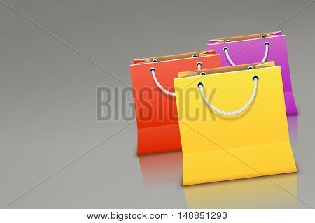 illustration of three different color bags on grey background
