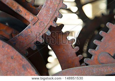 Old clockwork cogwheels close up