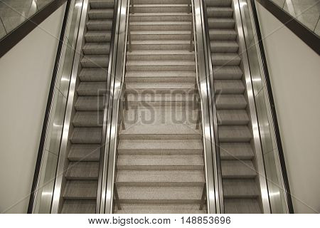 Empty escalator from above, one of them slightly motion blurred