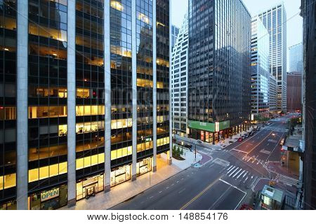 NEW YORK, USA - SEP 07, 2014: Crossroads of Wall Street and Water Street near the twenty-nine-storey office building in New York