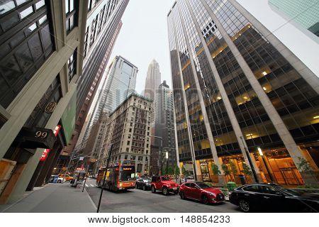 NEW YORK, USA - SEP 07, 2014: Wall Street near the twenty-nine-storey office building in New York
