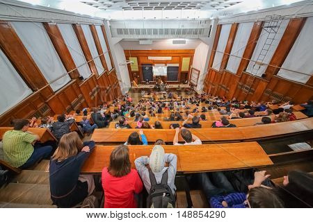 MOSCOW, RUSSIA - JUN 06, 2014: group of students to listen to lectures and watch in audience in Moscow State University.
