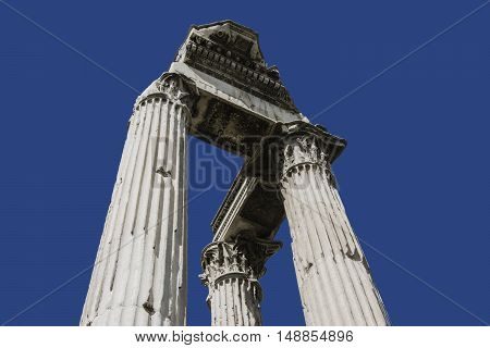 Three ancient columns form Temple of emperor Vespasianus ruins in Roman Forum