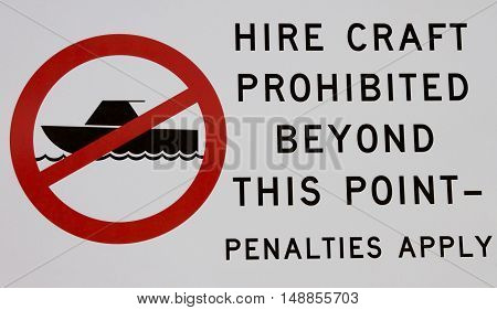 Hire craft prohibition signage at a lake.