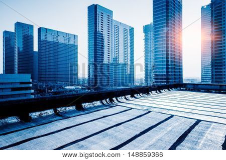 modern office block buildings against sunbeam,blue toned,
